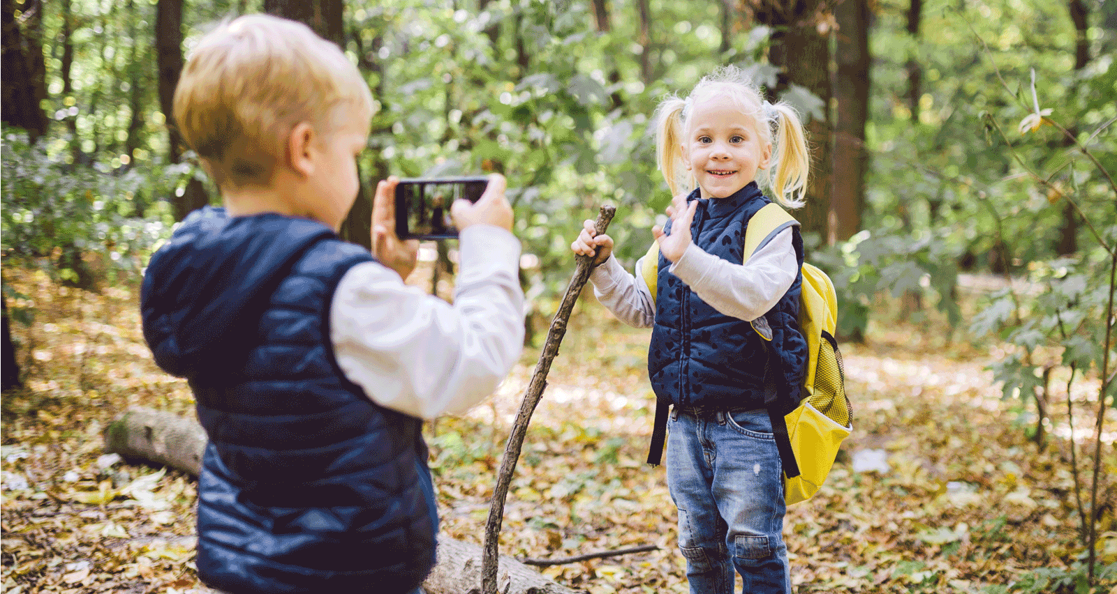 kids in woods taking picture with cell phone